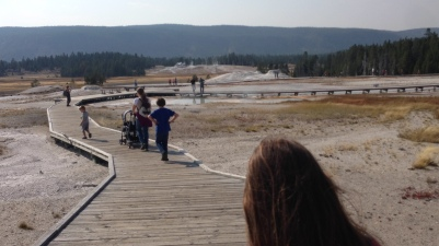 Walking the Geyser Basin with 2 squirrelly kids