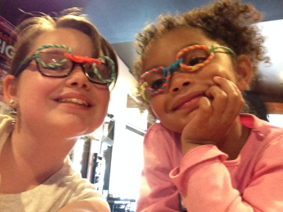 EL and CJ with glasses they made with the crafts that kids got at the pizza place
