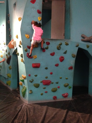CJ showing her stuff at the climbing wall