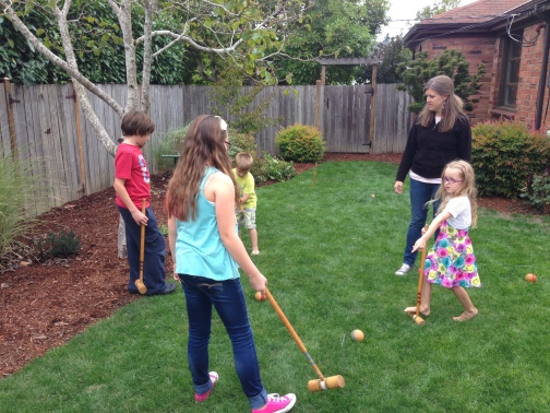Kids playing crocket