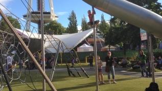 EC climbs a tall pole at the playground