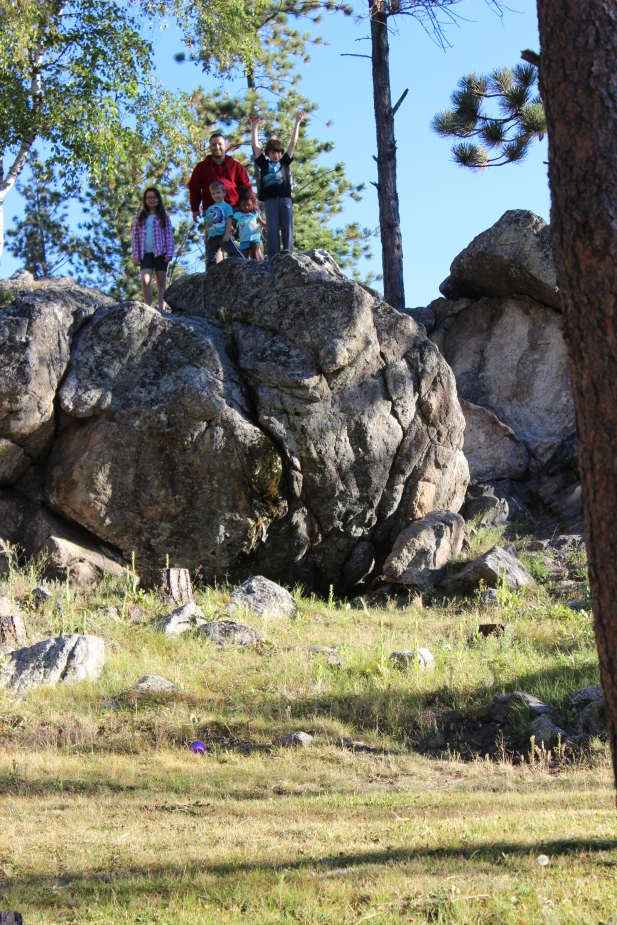 Climbing on the rocks just outside our cabin while waiting to leave Black Hills
