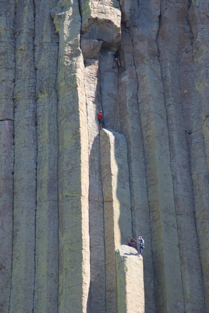 Extreme closeup on mountain climbers providing a frame of reference for the size of Devil's Tower