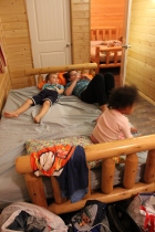 Kids relaxing in our Deluxe Cabin at the Greybull KOA