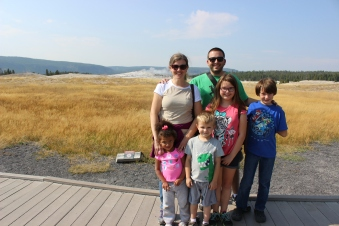 Family picture in front of Old Faithful