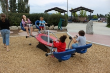 A 4-kid teeter totter seat thing