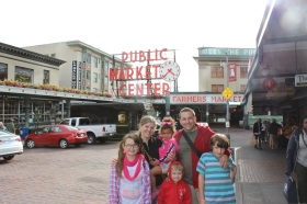 Family picture at the most photographed sign in Seattle - Pikes Place Market