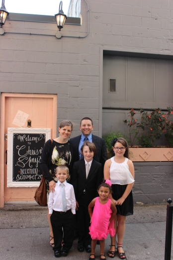 Family pic in front of the Pink Door
