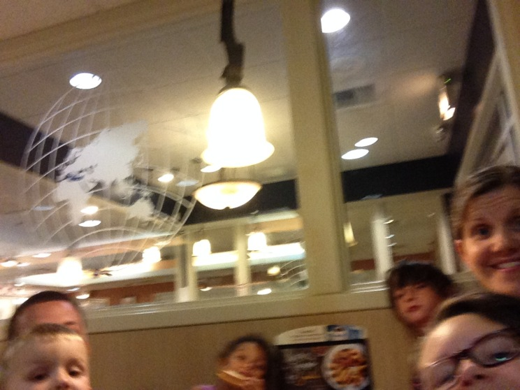 EL attempts to do a family selfie at IHOP - our dinner stop for the night