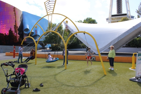 Playing at the park in the shadow of the Space Needle