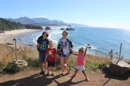 The kids with Haystack Rock in the background