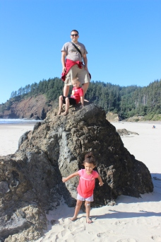 Climbing the rocks (they are sharp on bare feet!) at Ecola State Park