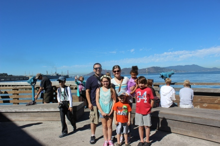 Family picture at the end of Pier 39 - with Alcatraz and Golden Gate in the background