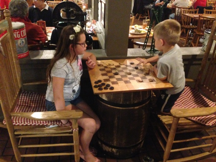 EL and EC playing checkers at the Cracker Barrel in Flagstaff